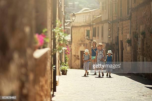 Family visiting beautiful mediterranean town.