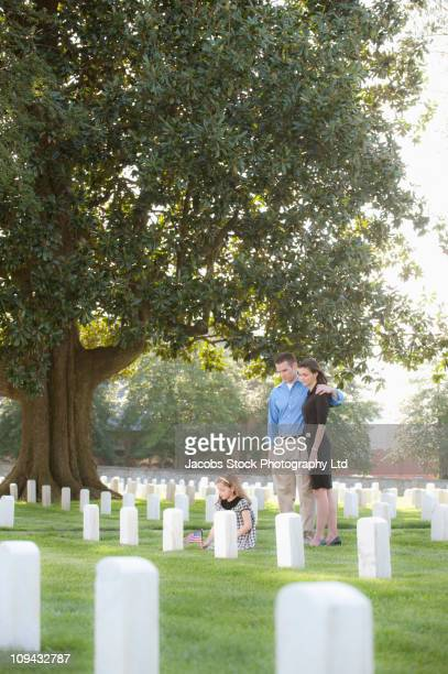 Family visiting cemetery together