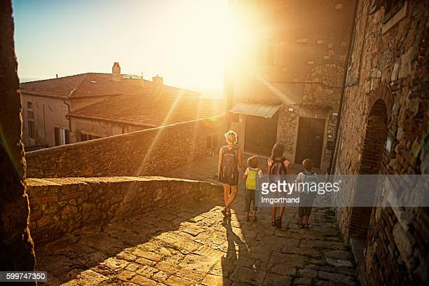 Family visiting charming Italian town in Tuscany