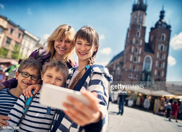 family visiting cracow, poland - krakow stock pictures, royalty-free photos & images