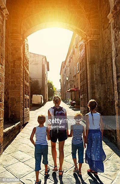 Family visiting italian town of Volterra, Tuscany