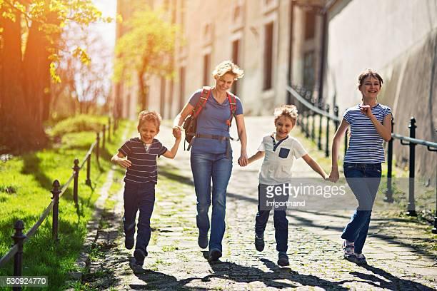 Family visiting Krakow running in old town