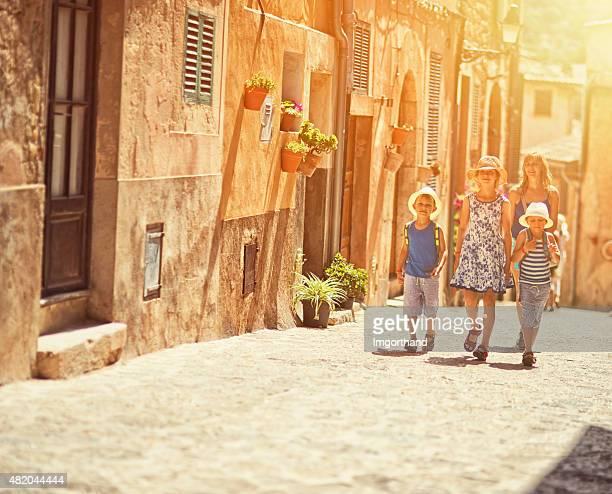 Family visiting mediterranean town of Valldemossa
