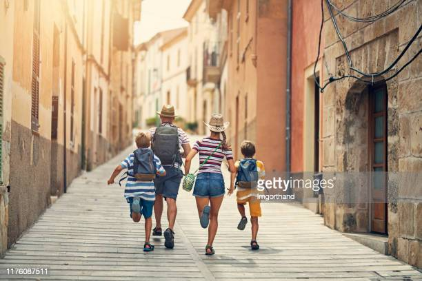 family visiting mediterranean town on majorca - spanish culture stock pictures, royalty-free photos & images