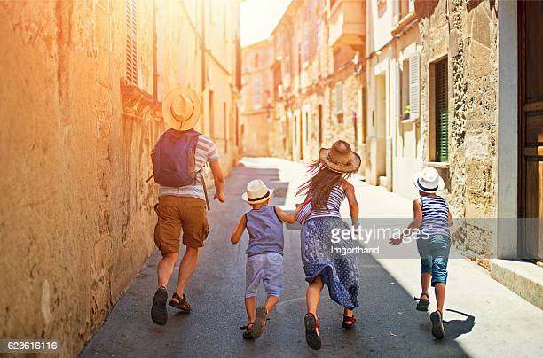 family visiting mediterranean town on majorca - majorca stock pictures, royalty-free photos & images