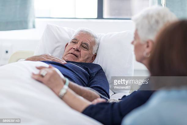 Family visiting senior patient in hospital