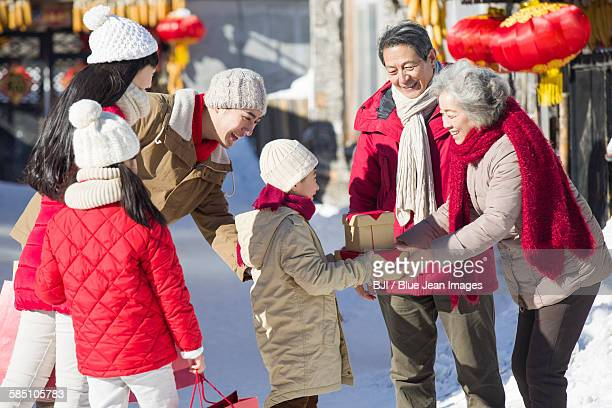 Family visiting with gifts during Chinese new year