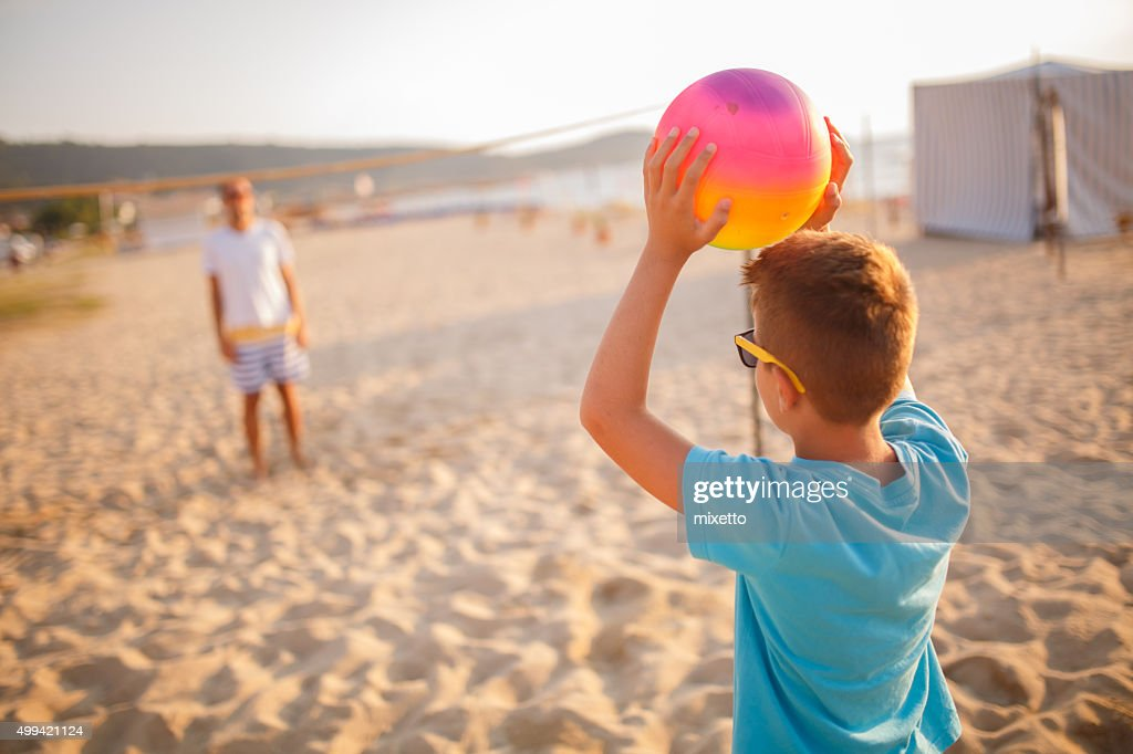 Family volleyball on beach : Stock Photo