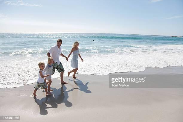 Family wading in ocean
