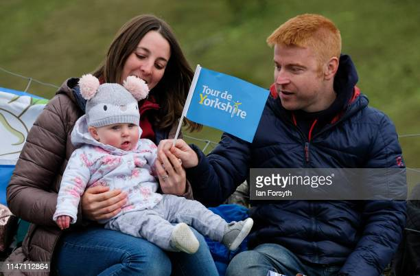A family wait for the peloton to arrive on the Cote de Park Rash ascent near the village of Kettlewell in the Yorkshire Dales during the fourth and...