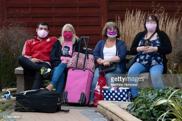 Family wait for transport after they were made to leave Trecco Bay holiday park on September 22, 2020 in Porthcawl, Wales. Trecco Bay is Europe's...
