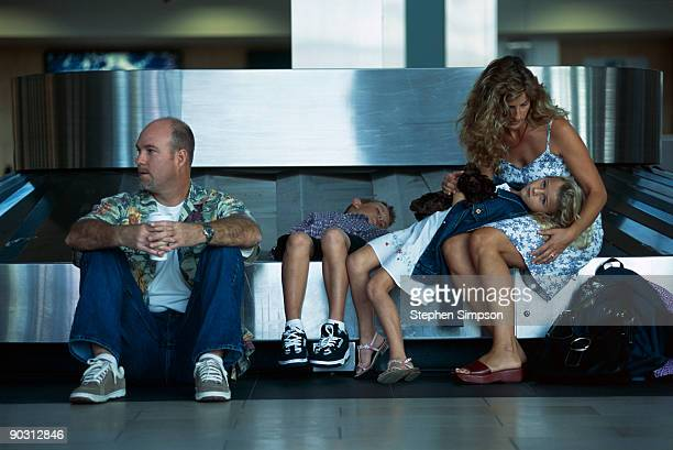 Family waiting at baggage claim