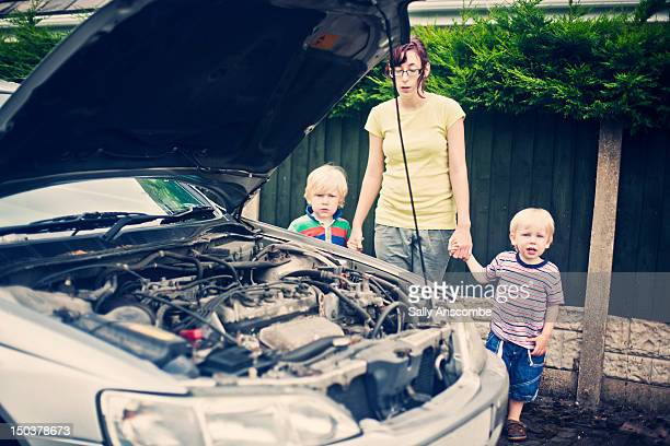 Family waiting by broken down car