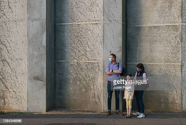 family waiting by wall - family with one child stock pictures, royalty-free photos & images