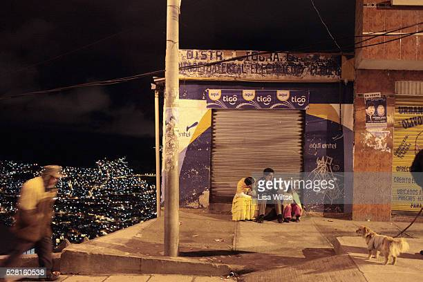 Family waiting for the bus in El Alto, Bolivia and January 26, 2010. The city of El Alto, outside Bolivia's capital La Paz, is home to some one...
