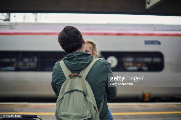 family waiting for the train - railway station stock pictures, royalty-free photos & images