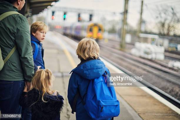 family waiting for the train - waiting stock pictures, royalty-free photos & images