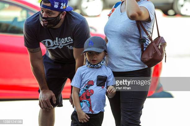 Family waits in line to get inside there theater at the screening of Shang-Chi and the Legend of the Ten Rings at AMC theater on Saturday, Sept. 4,...