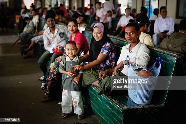 Family waits in the Pansodan ferry terminal for their boat to Dalat village on the other side of the Yangon River.