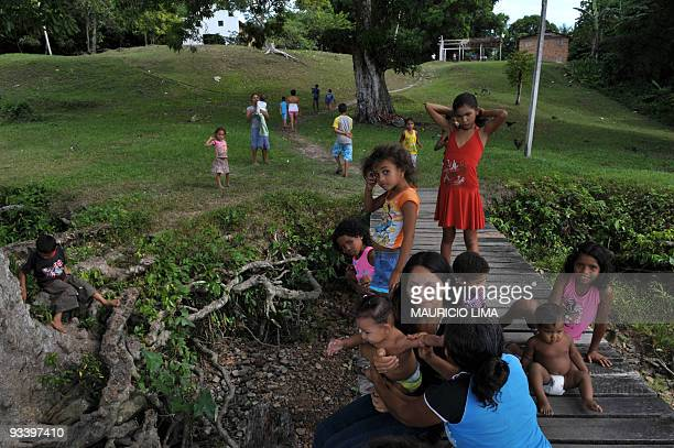 BURLEIGH A family waits on a bridge to receive medical care on board of Light of the Amazon hospital ship in Mocajuba Island located four hours...