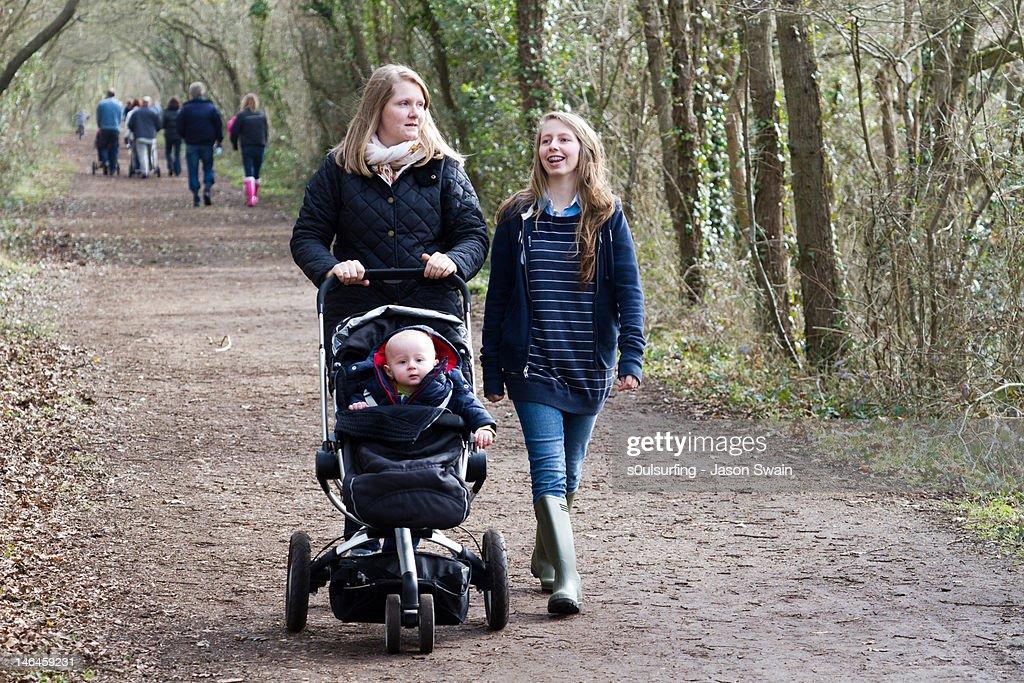 Family walk along riverbank : Stock Photo