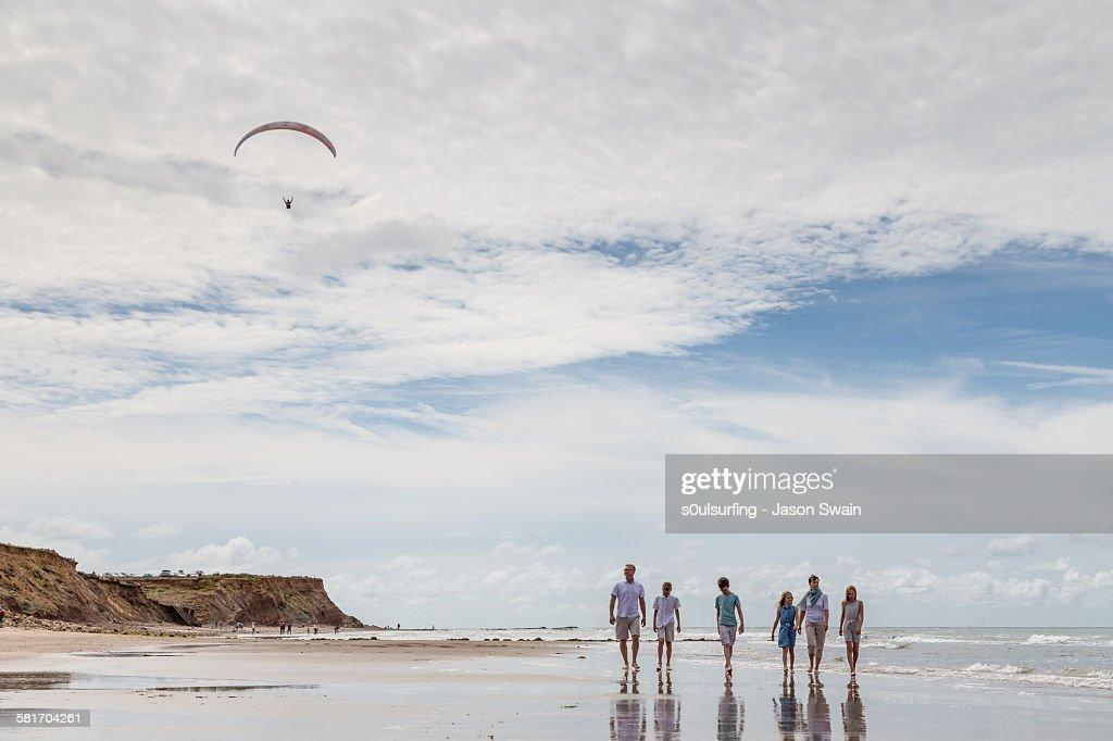 Family walk along the beach : Stock Photo