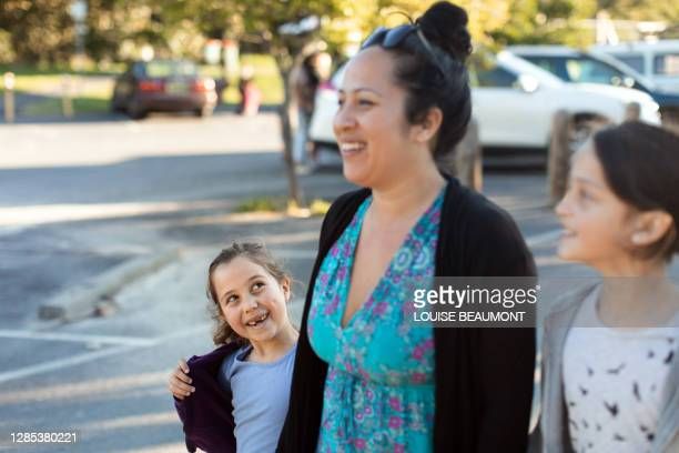 family walk around the block - mid adult women stock pictures, royalty-free photos & images
