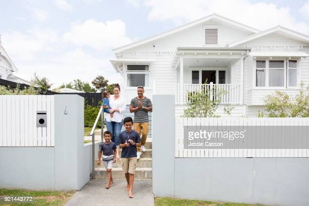 Family walk out  of the front gate to their home