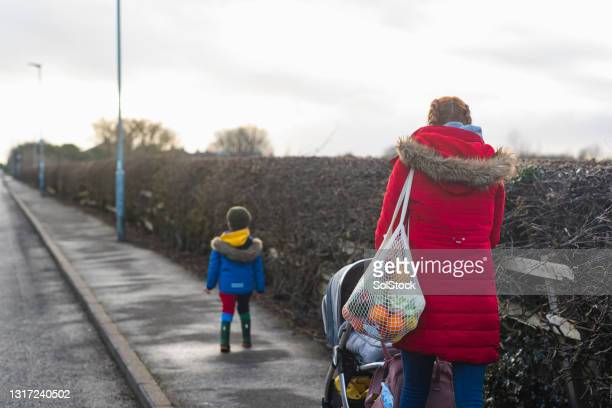 family walk - unrecognisable person stock pictures, royalty-free photos & images