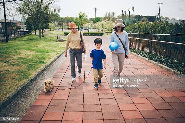 family walk - peter lourenco stock pictures, royalty-free photos & images