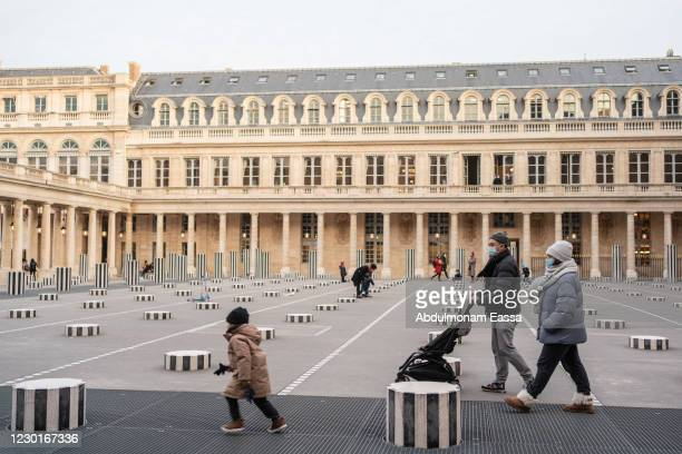 Family walk though the art installation Les Deux Plateaux by Daniel Buren in the Palais Royal courtyard on December 16, 2020 in Paris, France. With a...