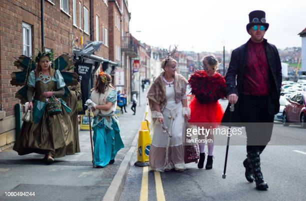 A family walk through town during Whitby Goth Weekend on October 28 2018 in Whitby England Whitby Goth weekend began in 1994 and takes place twice...