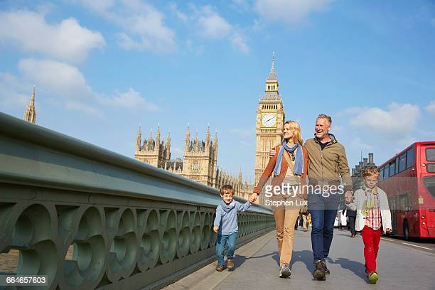 Family walking across westminster bridge