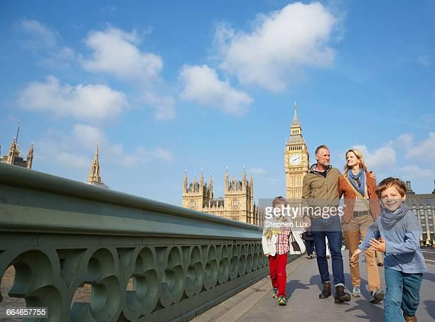 Family walking across westminster bridge