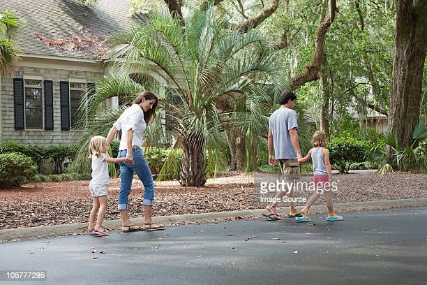 family walking along holding hands - hilton head stock pictures, royalty-free photos & images