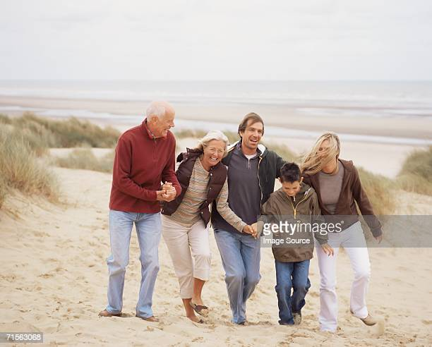 Family walking along the beach