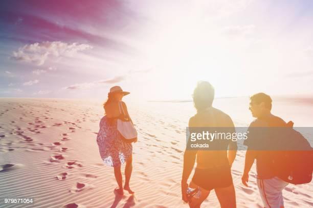 family walking at lençois maranhenses - maranhao state stock pictures, royalty-free photos & images