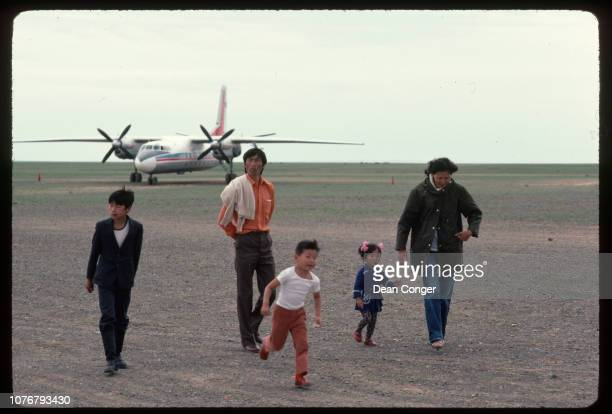 Family Walking Away From a Plane Mongolia