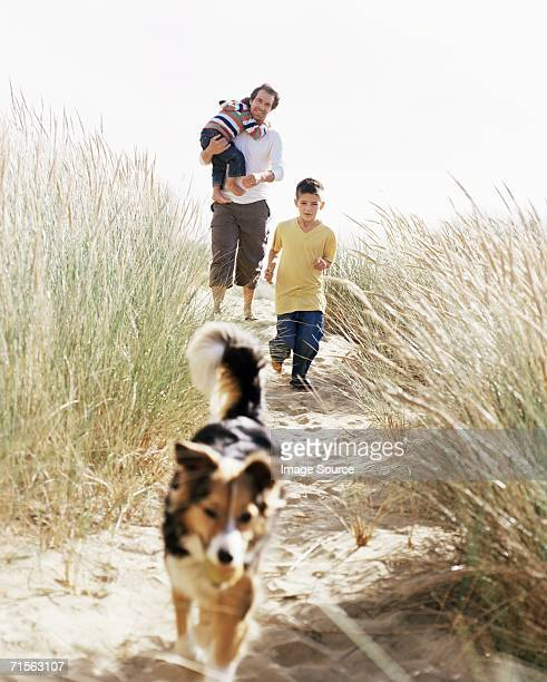 Family walking down a dune