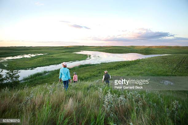 family walking down hill - north dakota stock pictures, royalty-free photos & images
