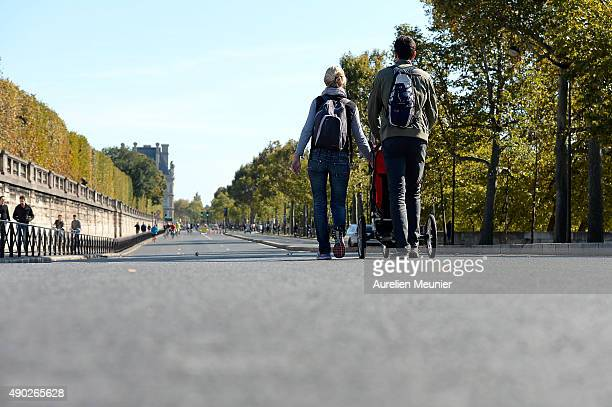 A family walking down les Quais during the car free day on September 27 2015 in Paris France Today between 11am to 6pm Central Paris is to go car...