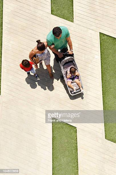 Family walking in city square