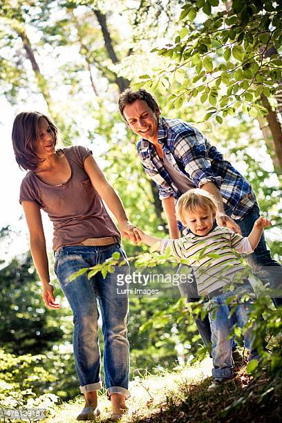 Family walking in forest, Bavaria, Germany