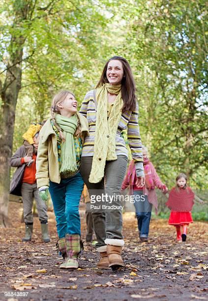 Family walking in park in autumn