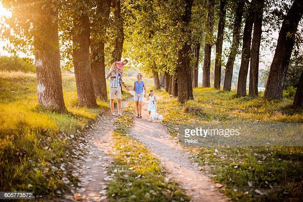 Family walking in the forest with their family dog
