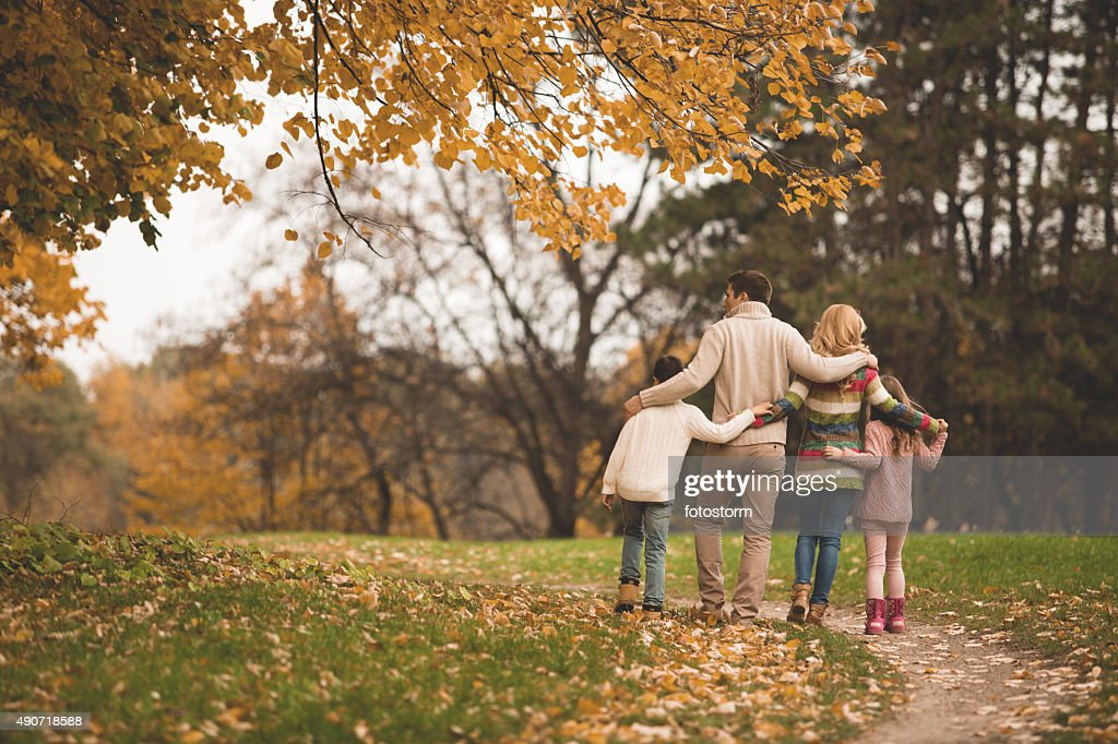 Family walking in the park : Stock Photo