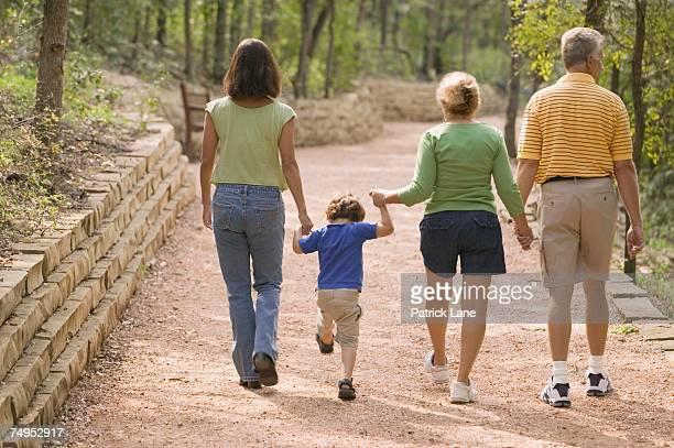 family walking in the park - チノパンツ ストックフォトと画像
