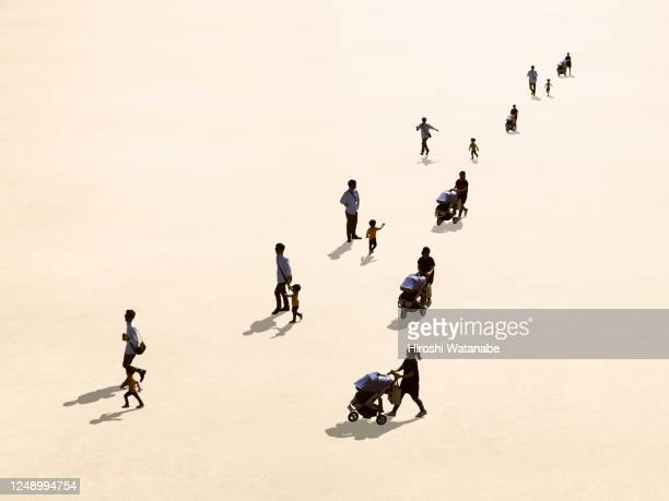 family walking in the square - 多様性  ストックフォトと画像