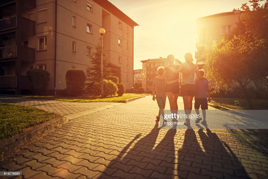 Family Walking In Urban Area High Res Stock Photo Getty Images