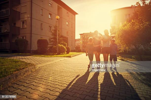 family walking in urban area - flat stock pictures, royalty-free photos & images